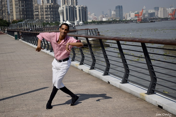 dancer with flat salsa dance shoes outside
