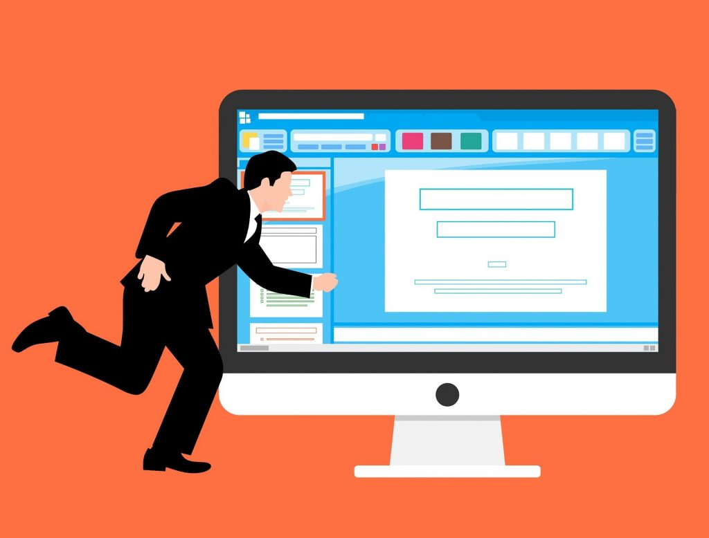 picture of a man running to a computer
