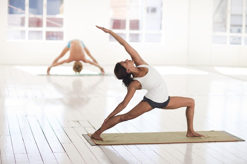 Female holding a yoga pose